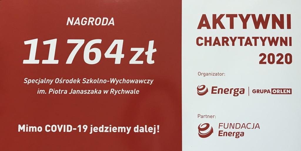 Obraz przedstawiający symboliczny czek dla SOSW w Rychwale przekazany przez Fundację Energa Aktywni Charytatywni 2020 na kwotę 11 tysięcy 764 złote.